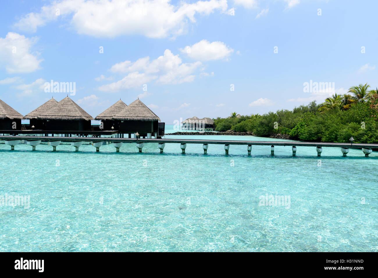 houses on piles on sea. Maldives Stock Photo