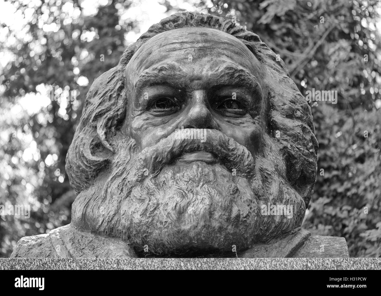 Karl Marks statue memorial tombstone grave at Highgate Cemetery East in London, England. - Stock Image