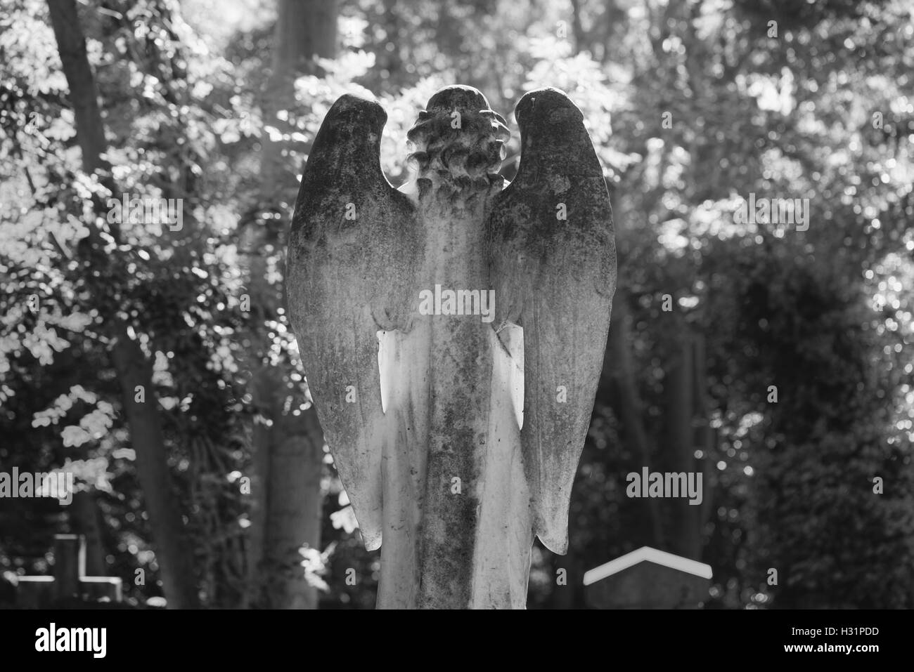Angel Tombstone Gravestone at Highgate Cemetery East in London, England. - Stock Image