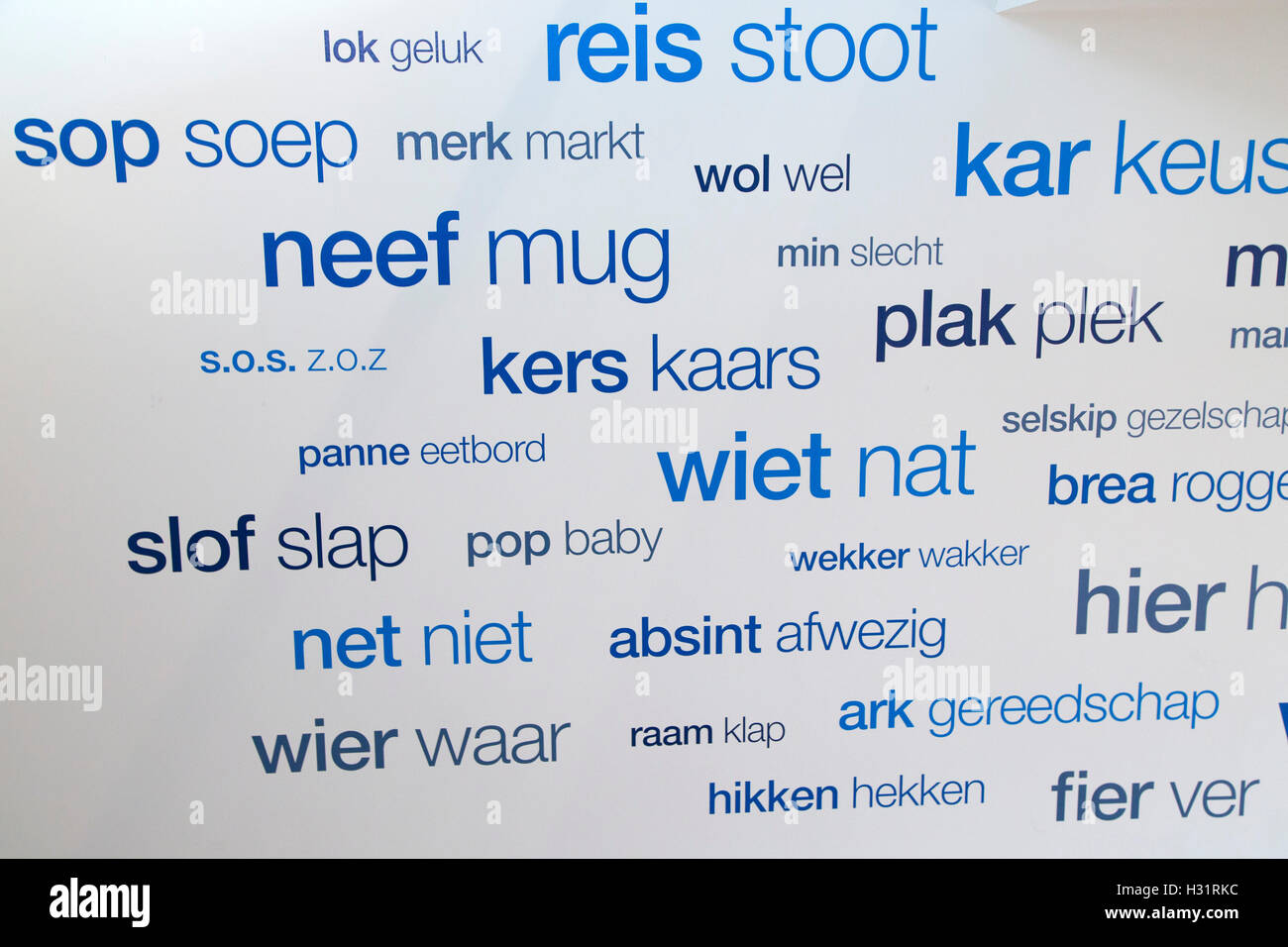 Dutch and Friesen words displayed side by side in Leeuwarden, the Netherlands. They occupy a corridor in the Fries - Stock Image