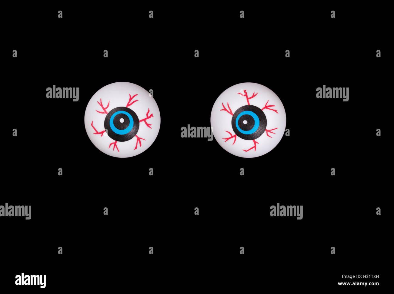 Scary eyeballs for Halloween season isolated on black background. - Stock Image