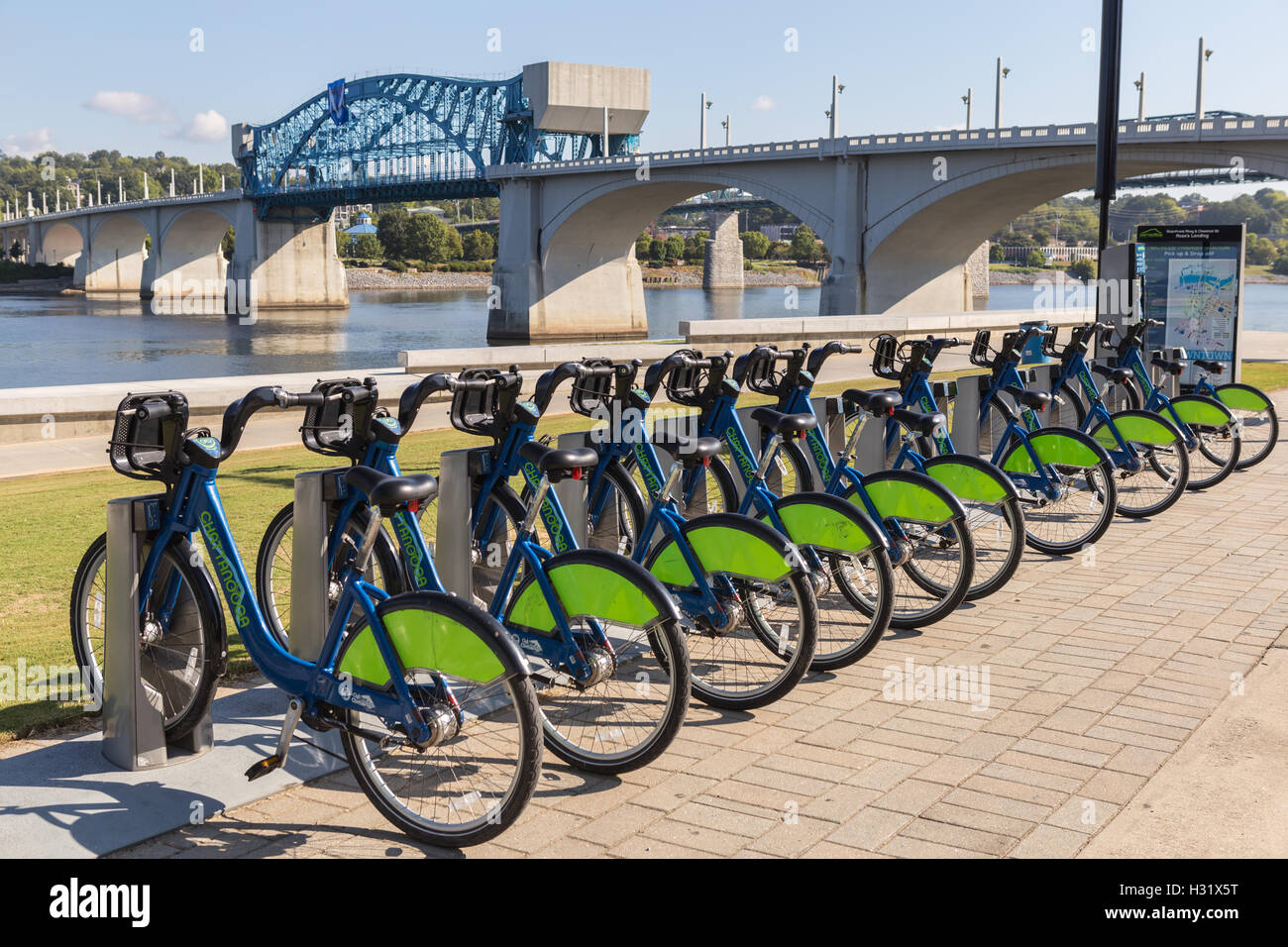Bikes wait for riders at a Bike Chattanooga Bicycle Transit System docking station at Ross's Landing in Chattanooga, - Stock Image