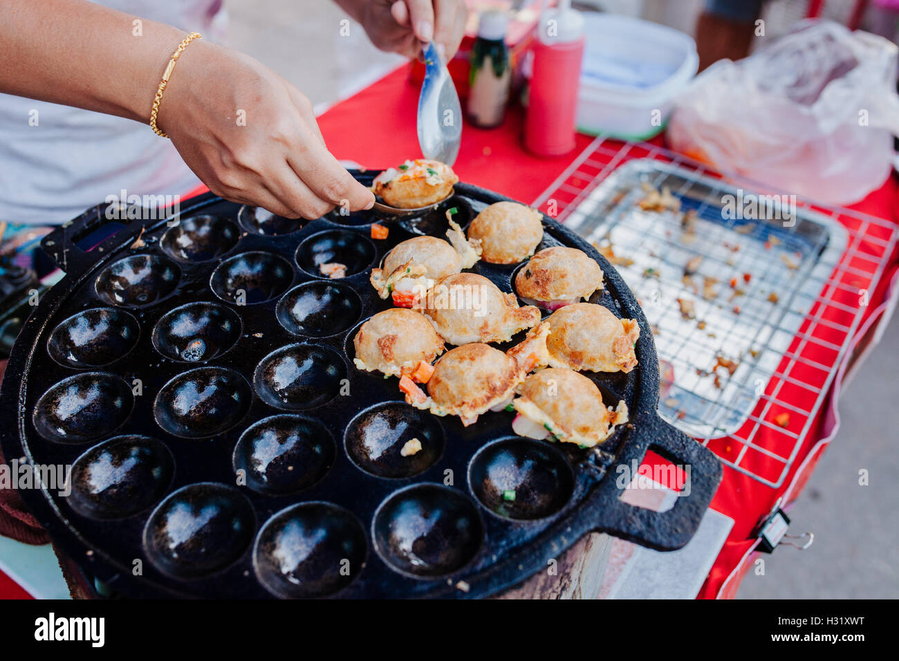 Sweet and Savory Grilled Coconut Rice Hot cakes it's for kanom krok but sometiems they use Coconut Rice Cake - Stock Image