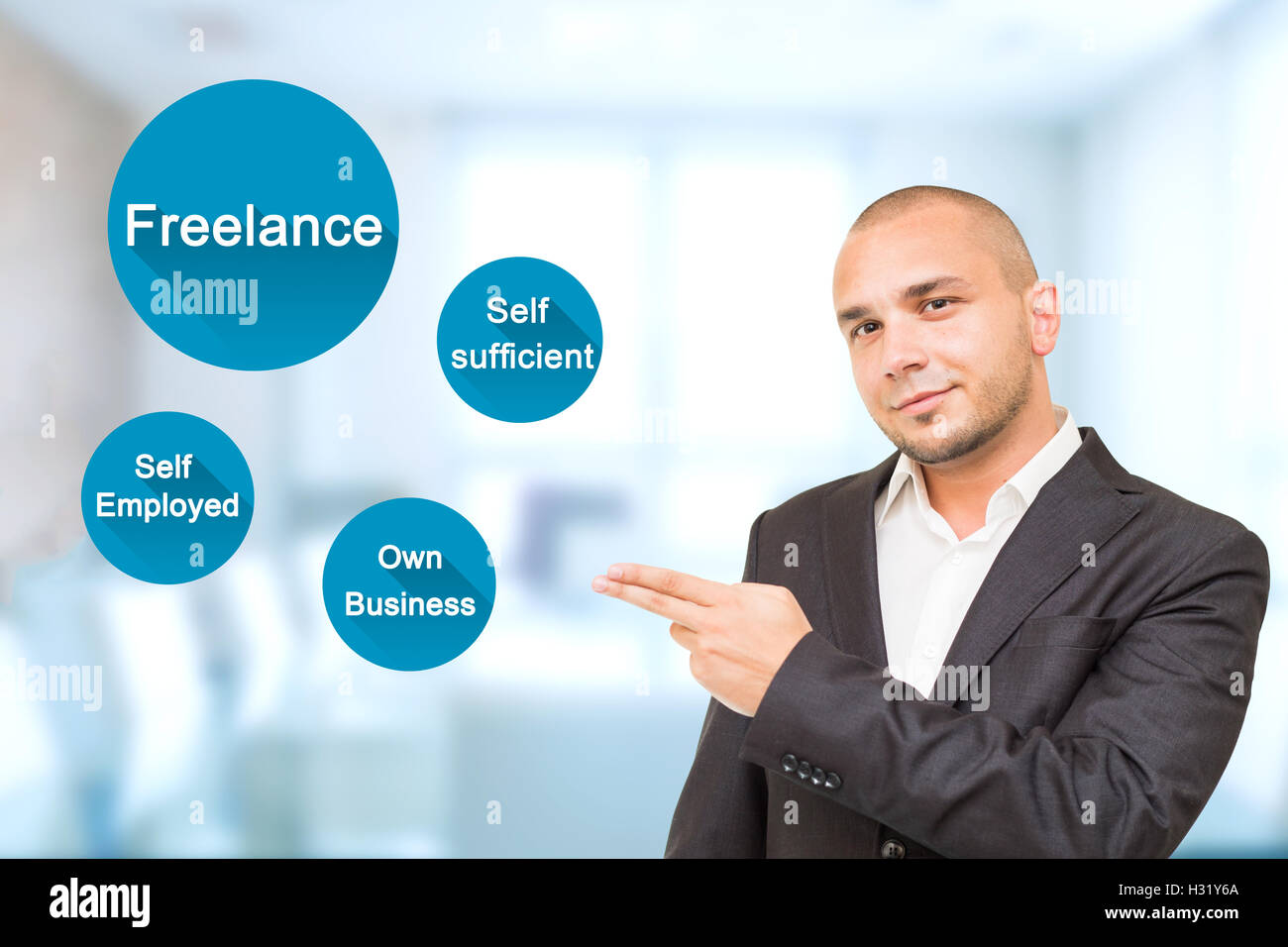 Young handsome man shows freelance work benefits - Stock Image