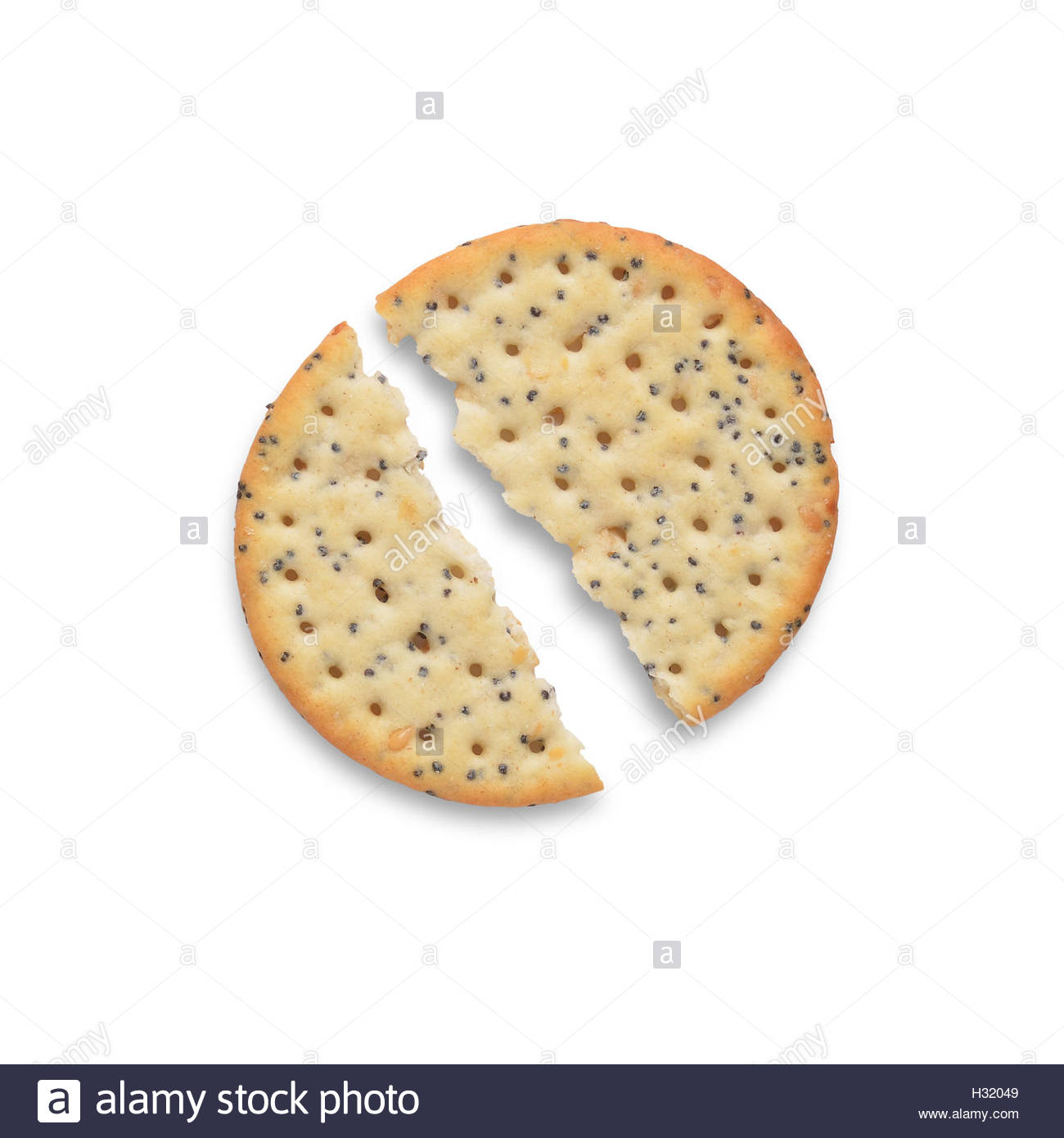 Broken poppy and sesame seed cracker isolated on white background, shot from above - Stock Image