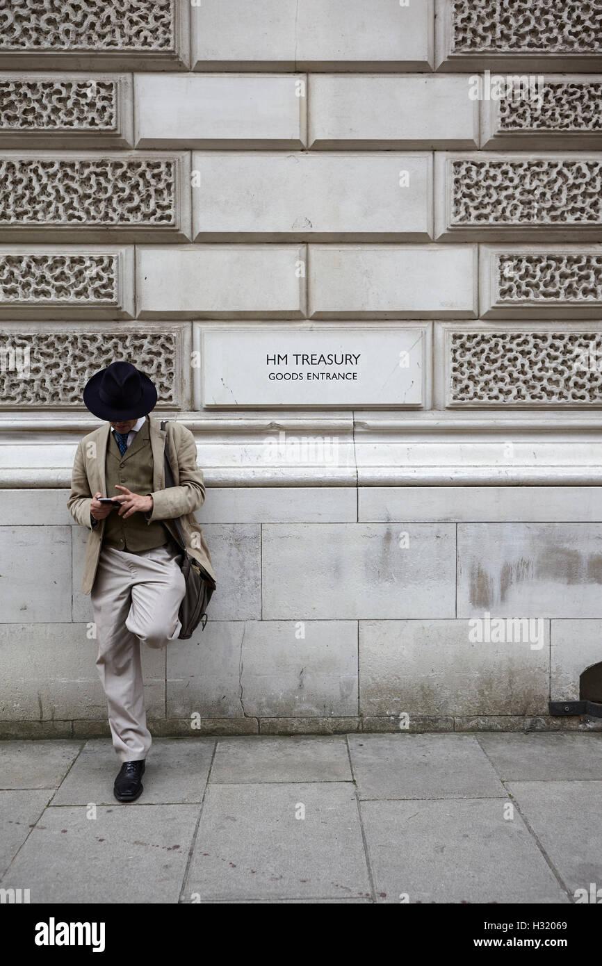 Dapper man outside HM Treasury London UK - Stock Image