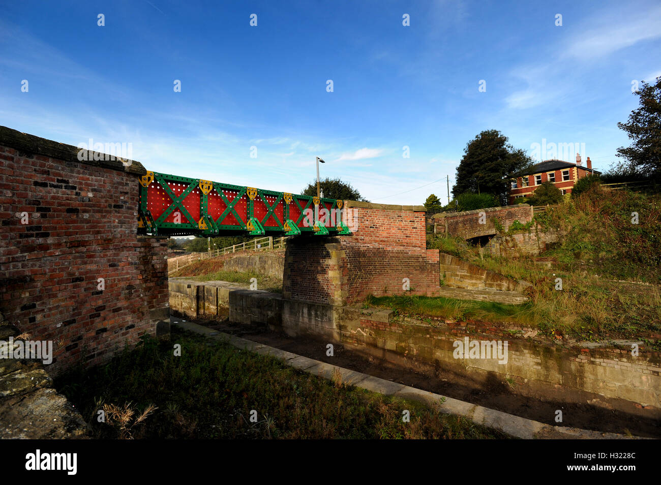 The newly installed 'Meccano' bridge overlooks continuing restoration work on the Manchester, Bolton and - Stock Image