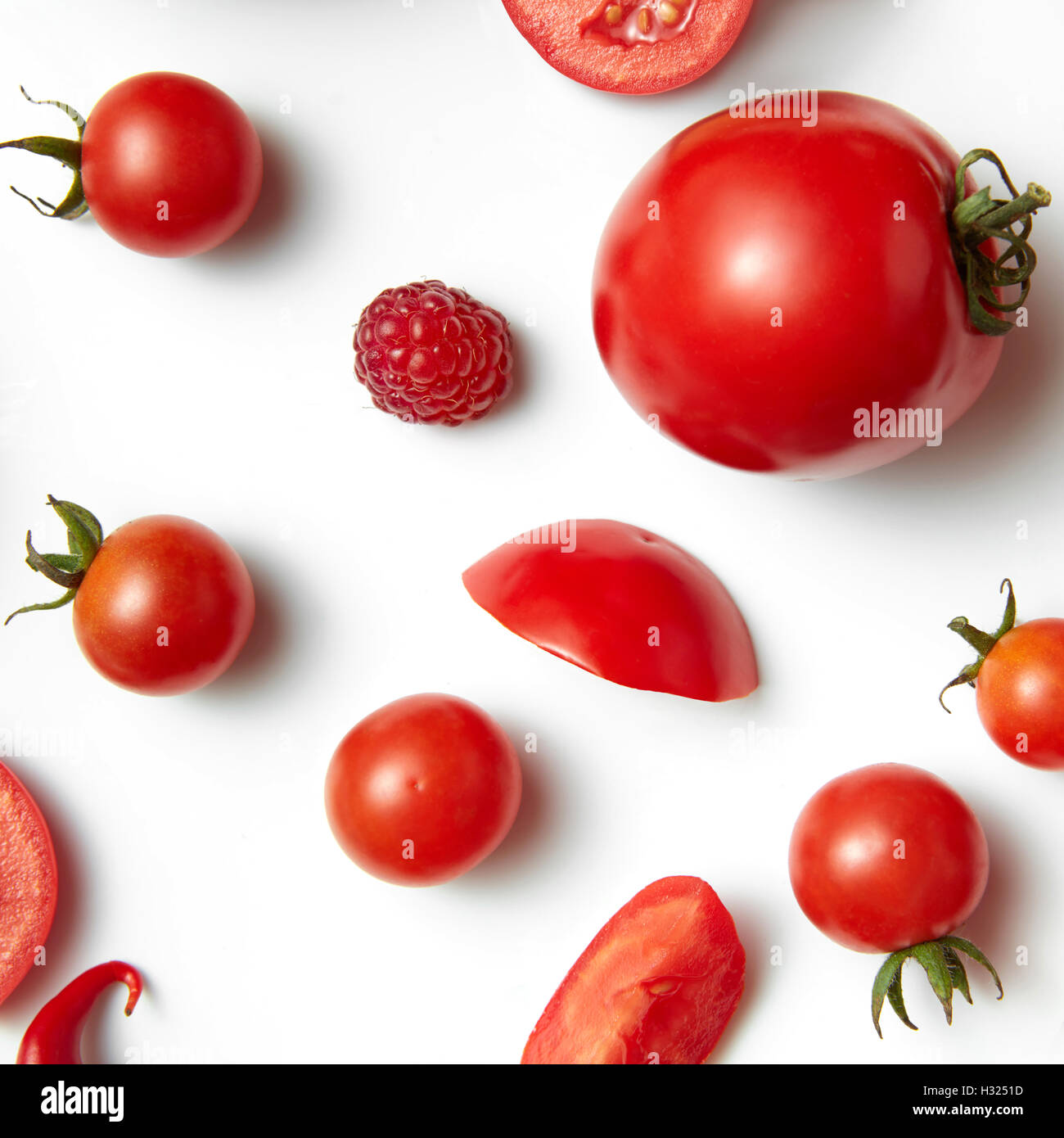 tomato cherry and raspberry isolated on white background - Stock Image
