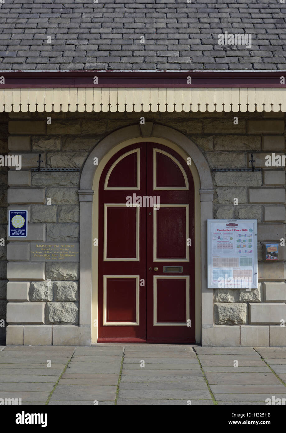 Arched stone door surround with double doors on station building at the east lancashire railway ramsbottom lancashire Stock Photo