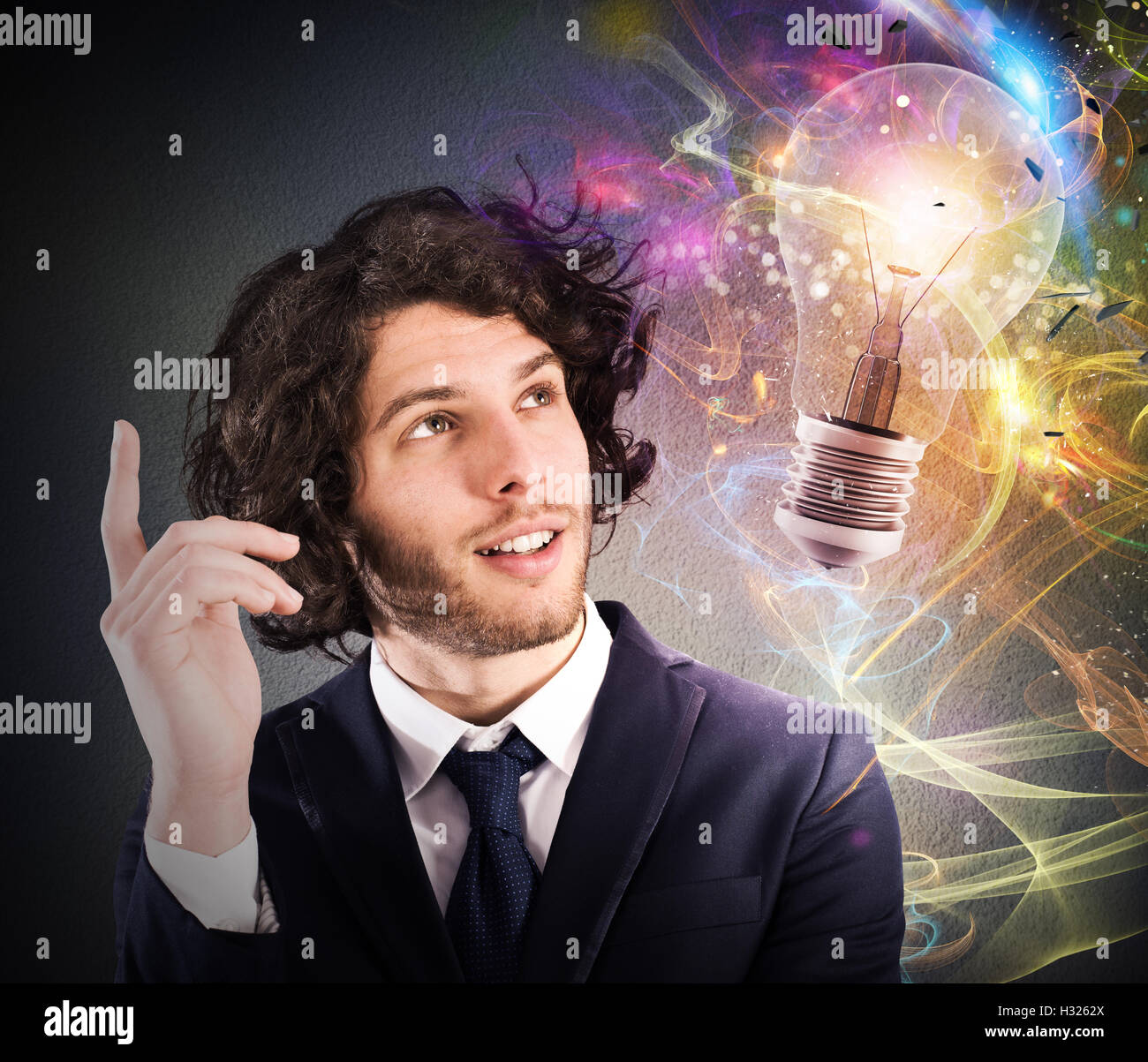 Businessman thinks of a new creative idea - Stock Image