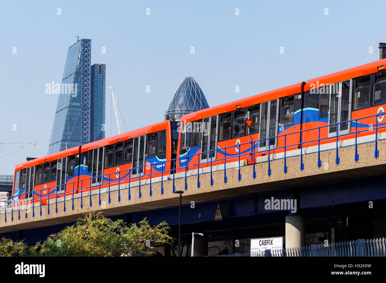 Docklands Light Railway train at Shadwell DLR station in London England United Kingdom UK - Stock Image