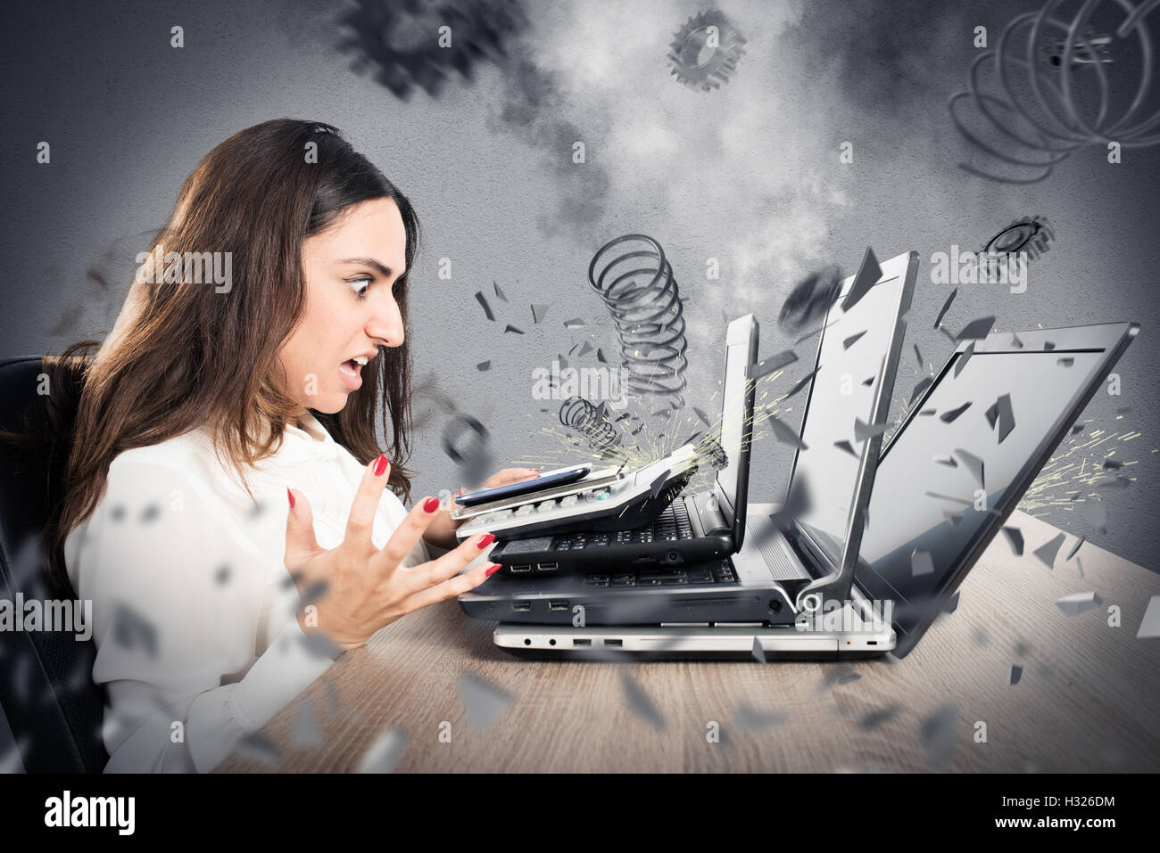Businesswoman overworked worn computers - Stock Image
