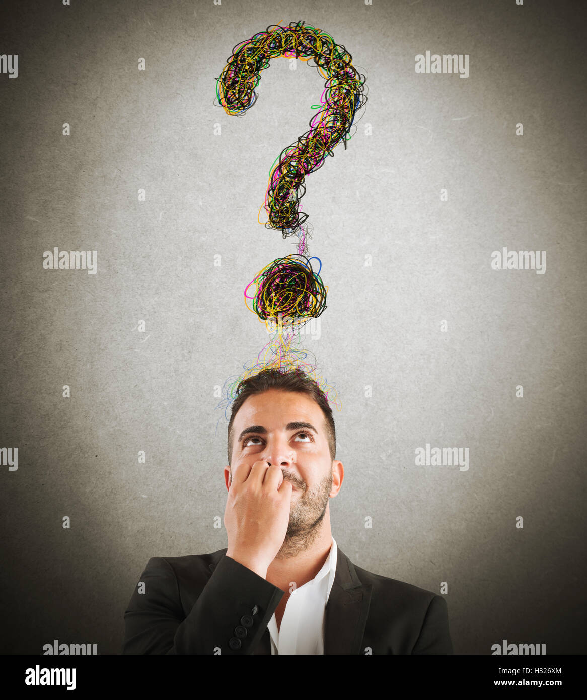 Businessman with big question - Stock Image