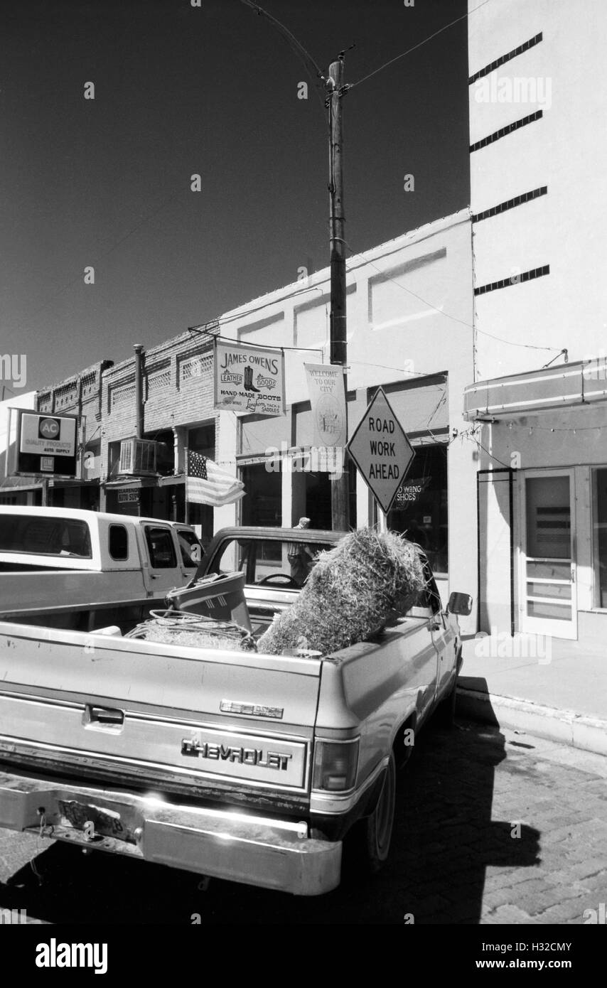 Trucks parked along the main street in town (scan from a b&w negative) Circa 1998 - Stock Image