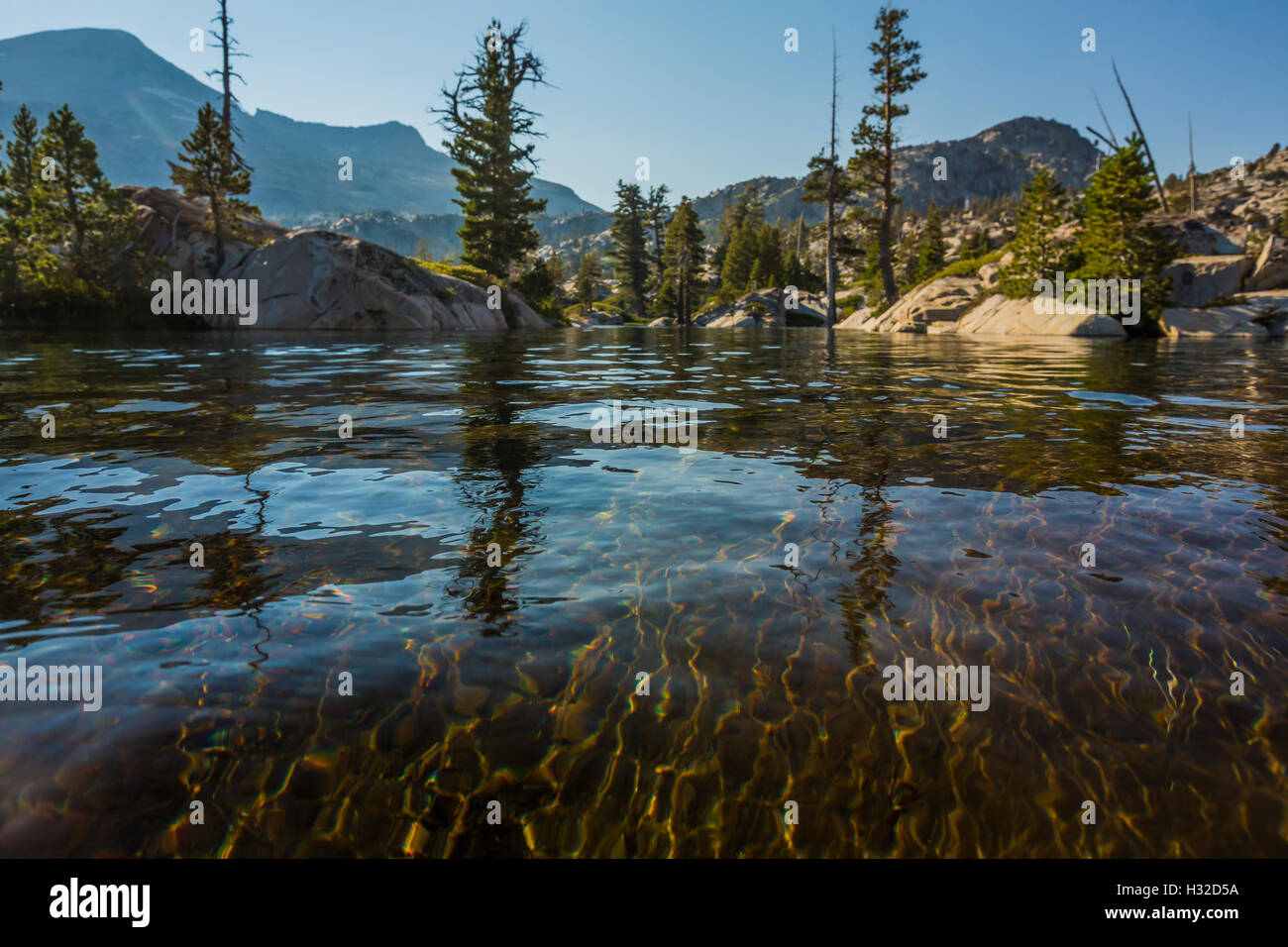 Water and granite at the shore at Ropi Lake in the Desolation Wilderness, Eldorado National Forest, California, - Stock Image