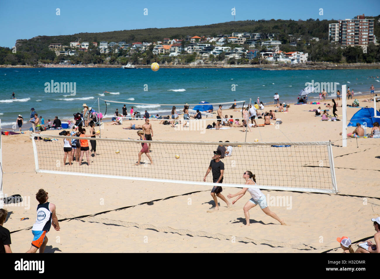 Manly beach, Sydney Australia, sunbathing and tanning along with beach volleyball matches,Sydney,Australia - Stock Image