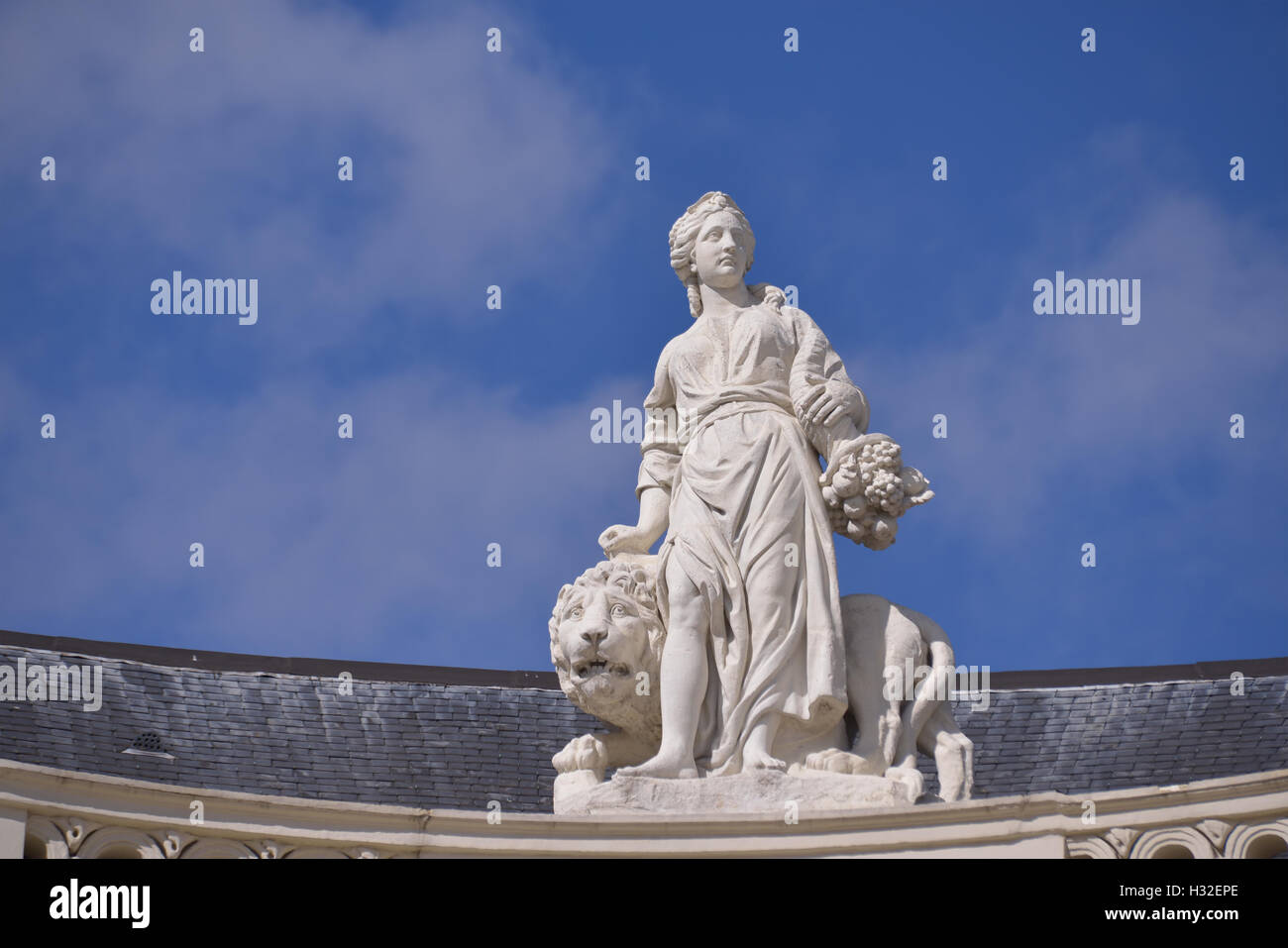 Allegory statue decorating roof of museum building Protestant Church in Brussels, Belgium - Stock Image