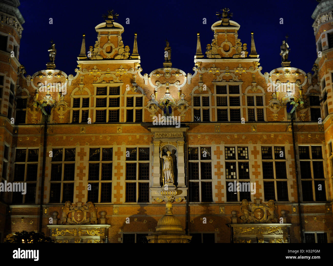 Poland. Gdansk. Great Arsenal. 17th centry. Mannerist. Architect Anthony van Obbergen (1543-1611). Night view. - Stock Image