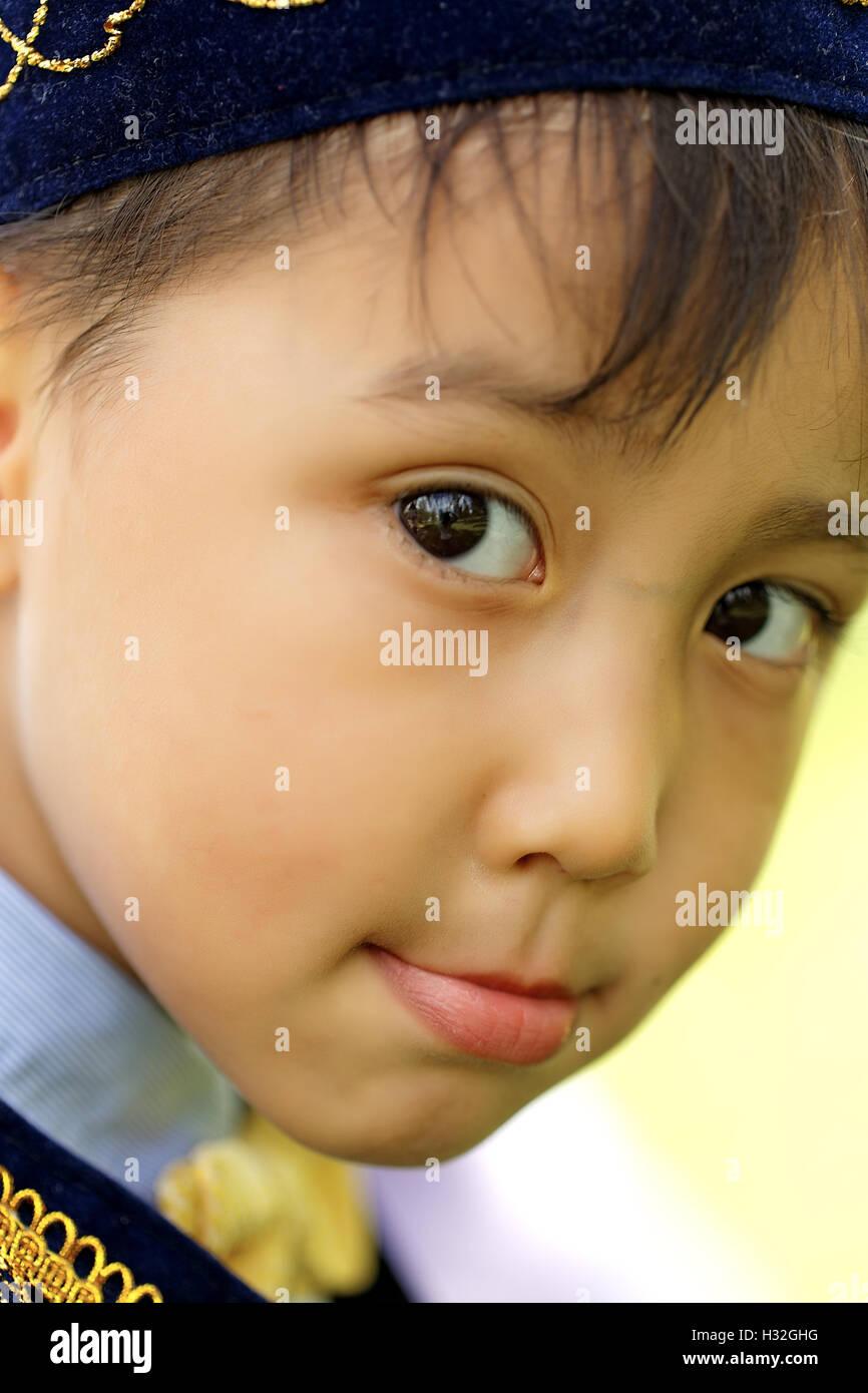 pretty little kazakh boy in national costume - Stock Image