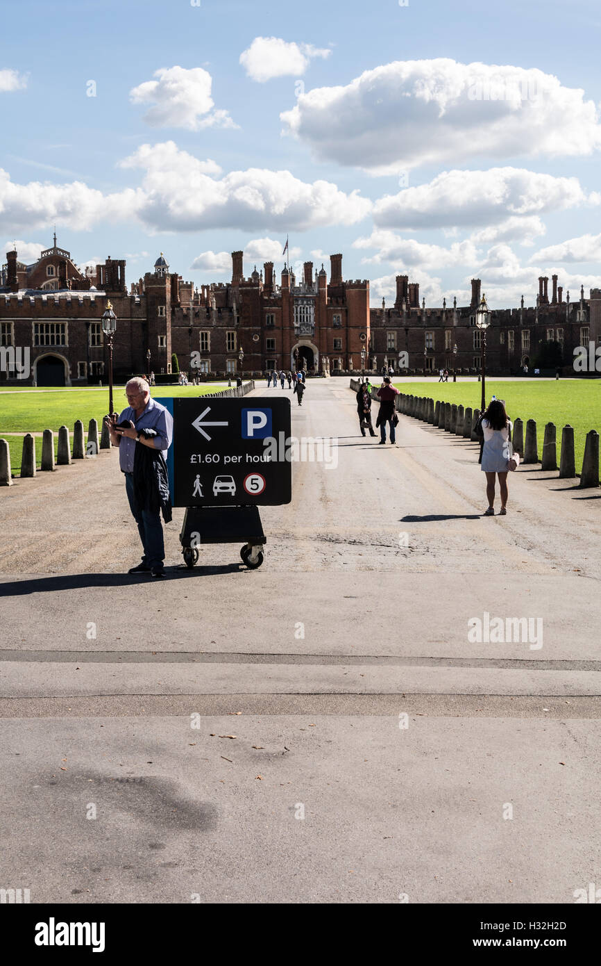 A car parking sign in front of Hampton Court Palace in Surrey, UK - Stock Image