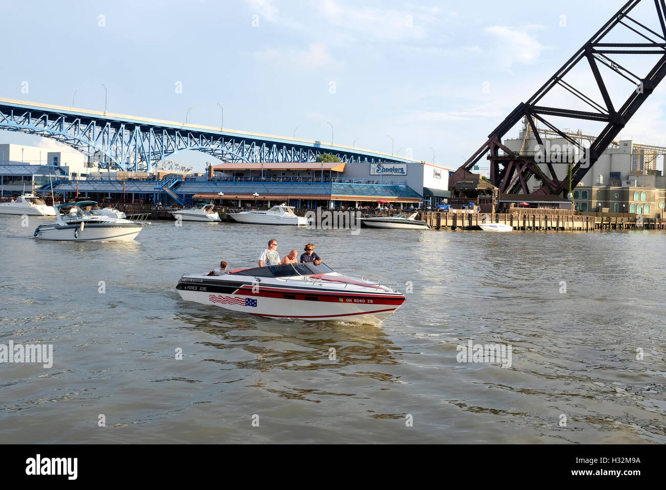 Boaters on the Cuyahoga River in The Flats in Cleveland, Ohio - Stock Image
