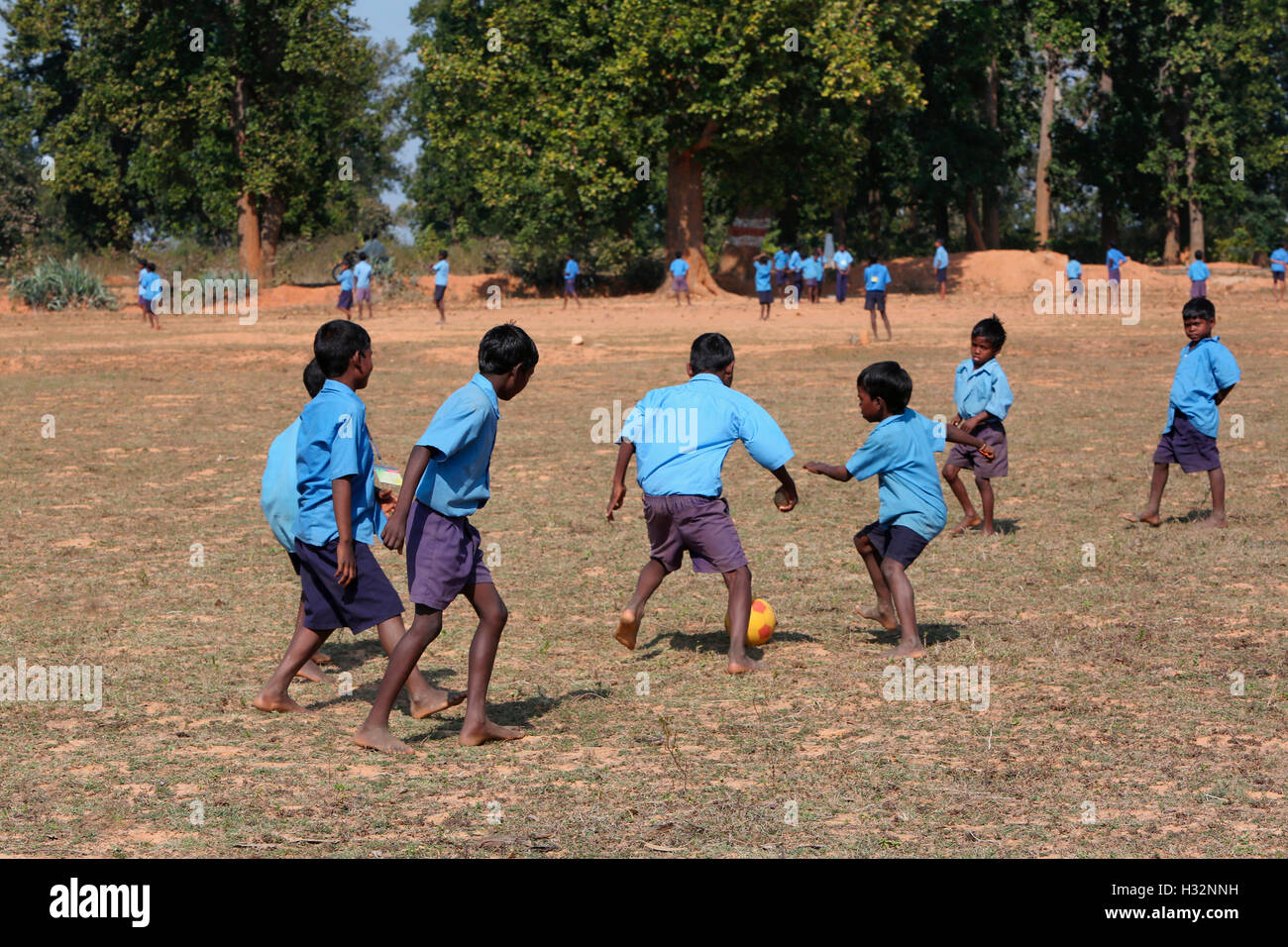 School Children playing Football, KHAIRWAR TRIBE, Anganwadi, Chiniya village, Chattisgarh, India - Stock Image