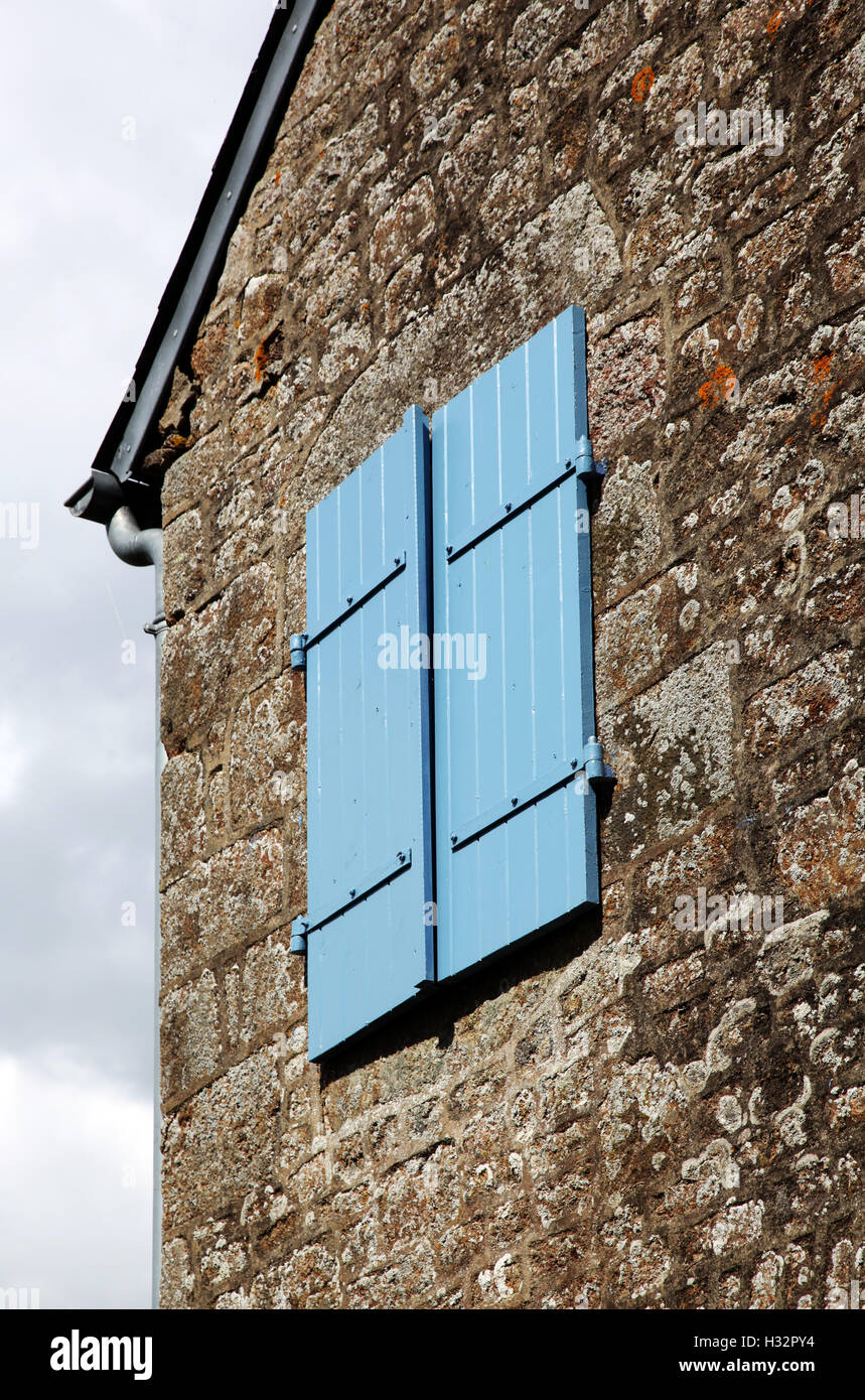 Blue Shutters on a stone house in Normandy, France Stock Photo ...