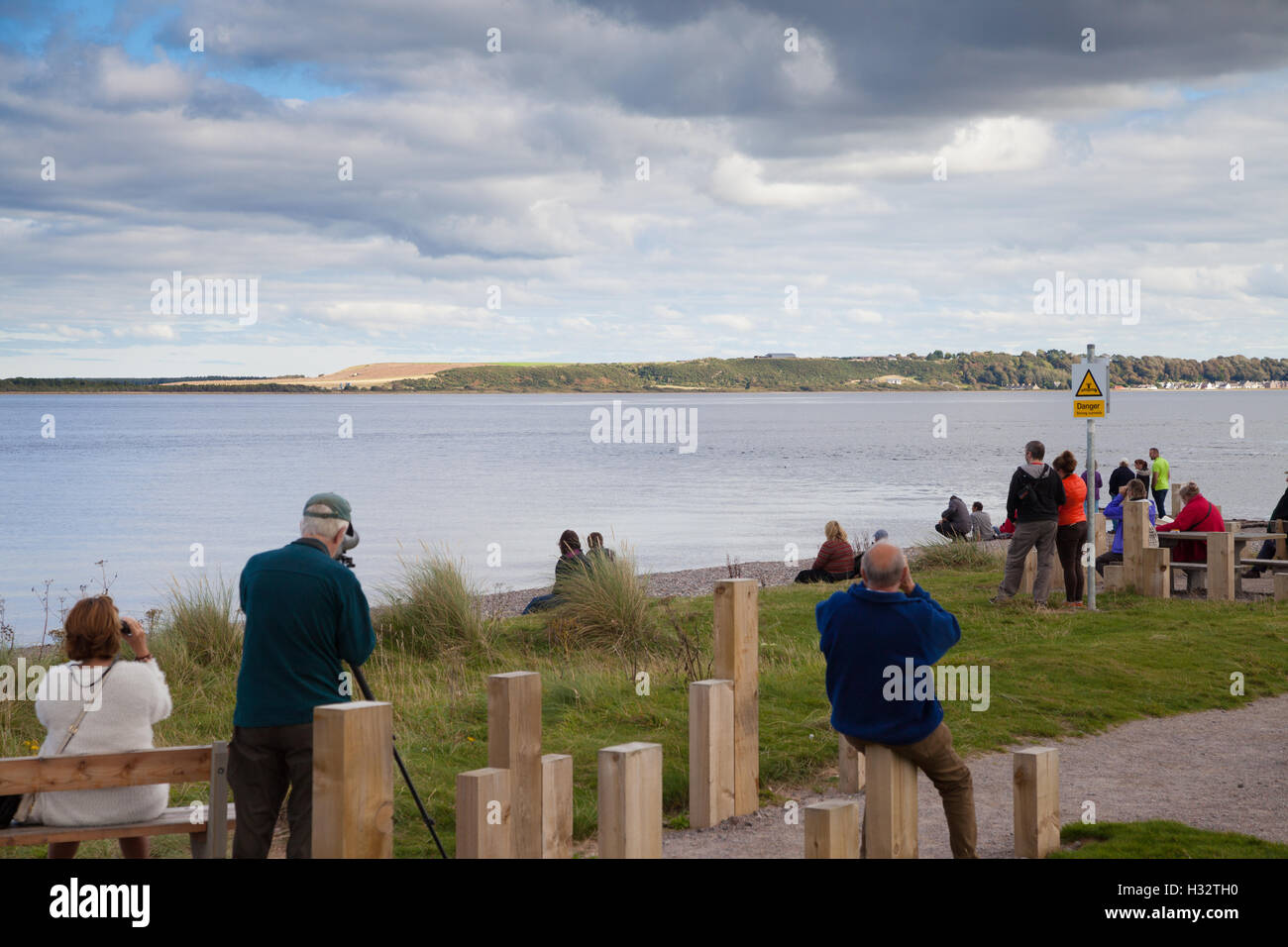 Dolphin watchers at Chanonry Point Moary Firth Highlands Scotland - Stock Image