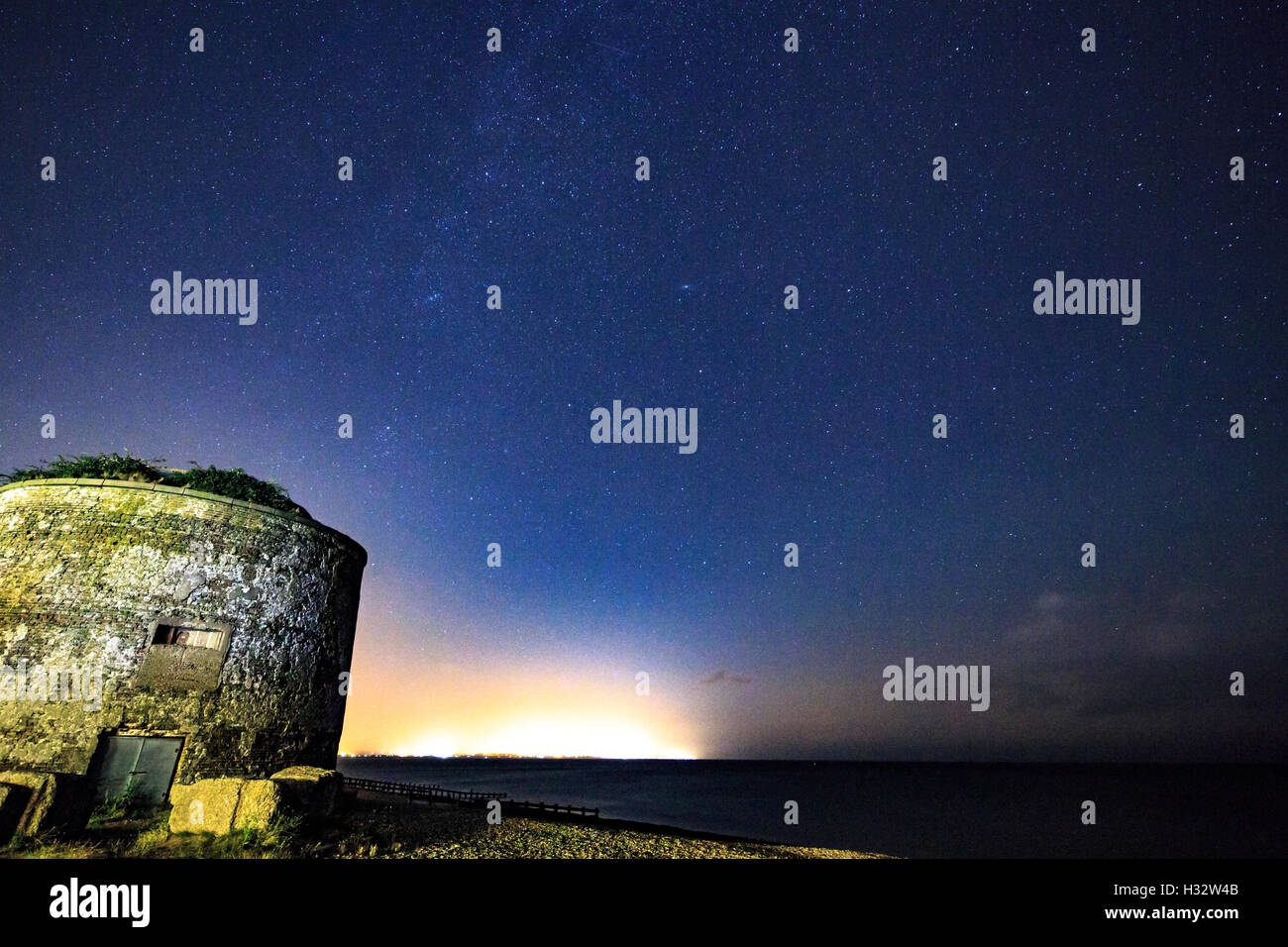 Star lit Martello Tower near Eastbourne Sovereign Harbour Sussex at Night - Stock Image