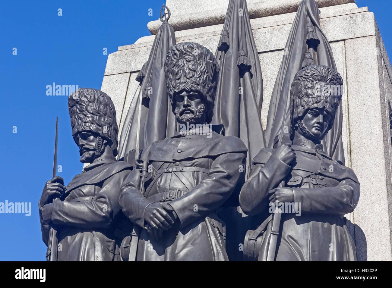 London, Waterloo Place   Grenadier guardsmen depicted on the Guards Crimea War Memorial - Stock Image