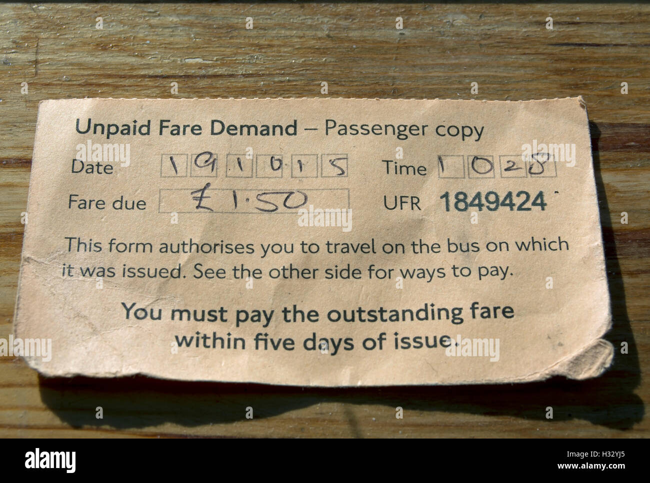 passenger copy of an unpaid fare demand issued by a london bus company - Stock Image