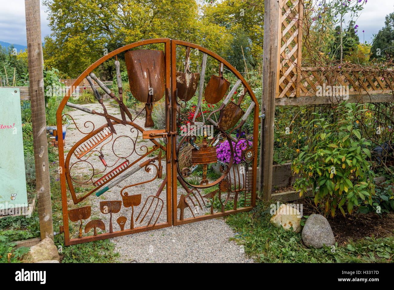 Community Garden Gate Made Of Old Rusty Tools.