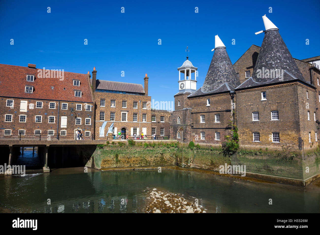 Three Mills (House Mill, Miller's House and the Clock Mill) in Bow, London, UK - Stock Image
