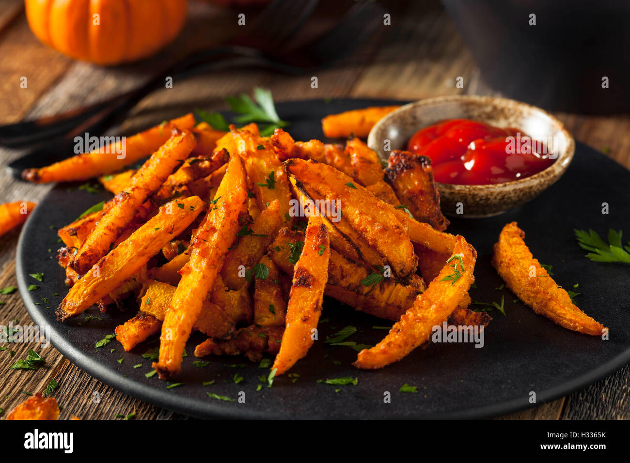 Homemade Organic Pumpkin French Fries with Ketchup - Stock Image