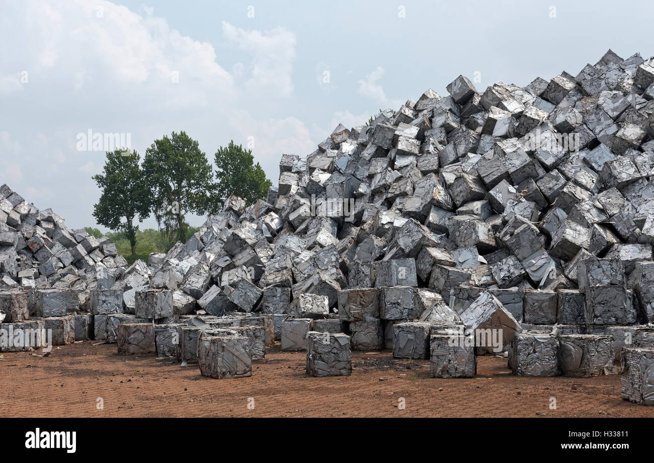 Mountain of scrap metal, pressed into cubes, metal waste from industrial production, Port of Duisburg, Duisport, - Stock Image