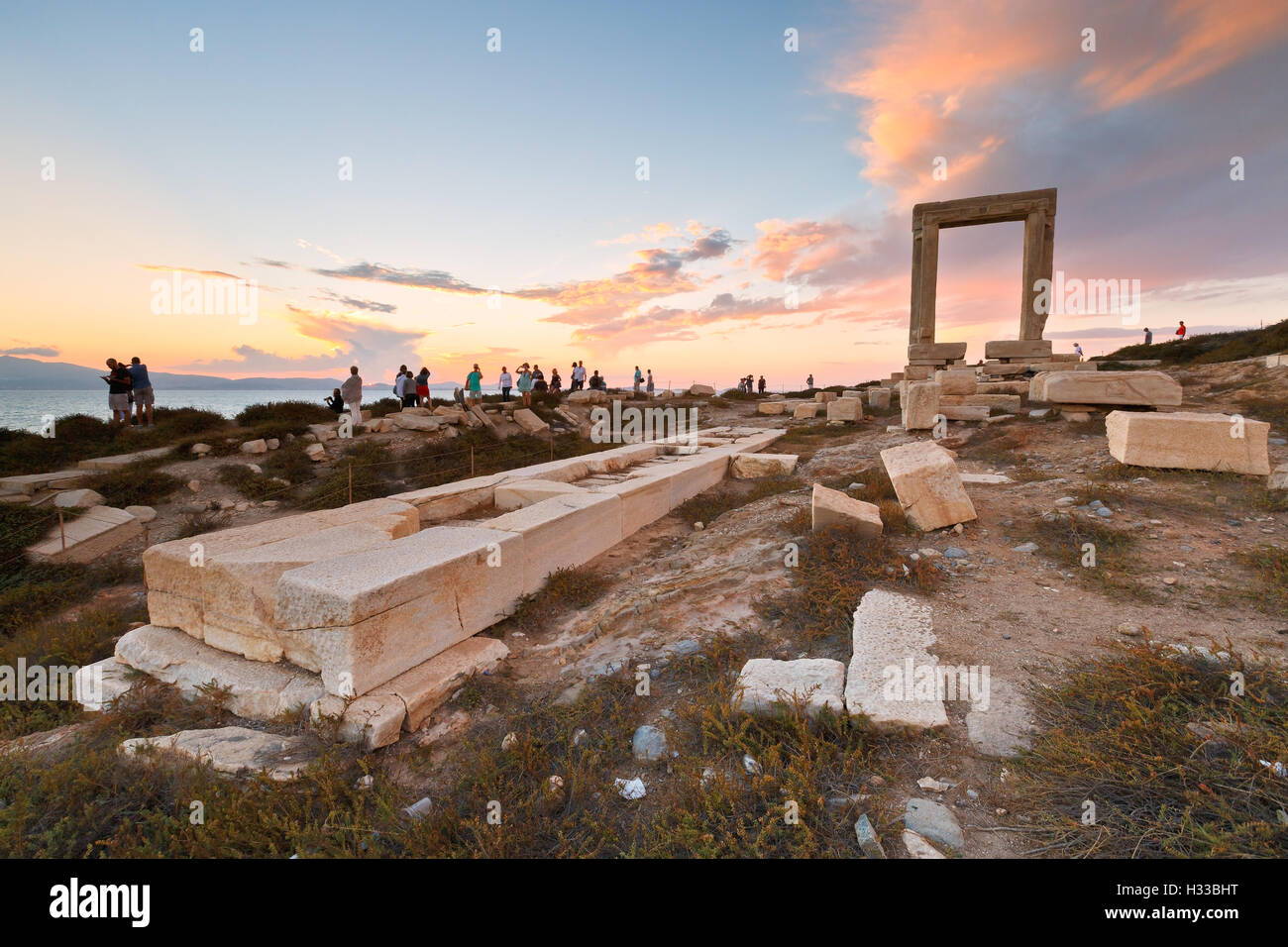 View of Portara and remains of temple of Apollo at sunset. - Stock Image