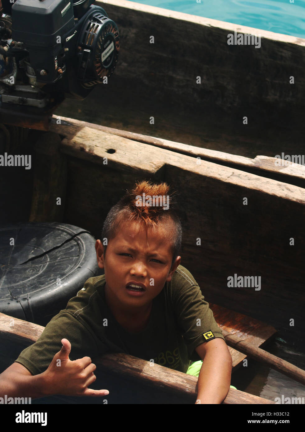 Child from the Mentawai Islands in canoe - Stock Image