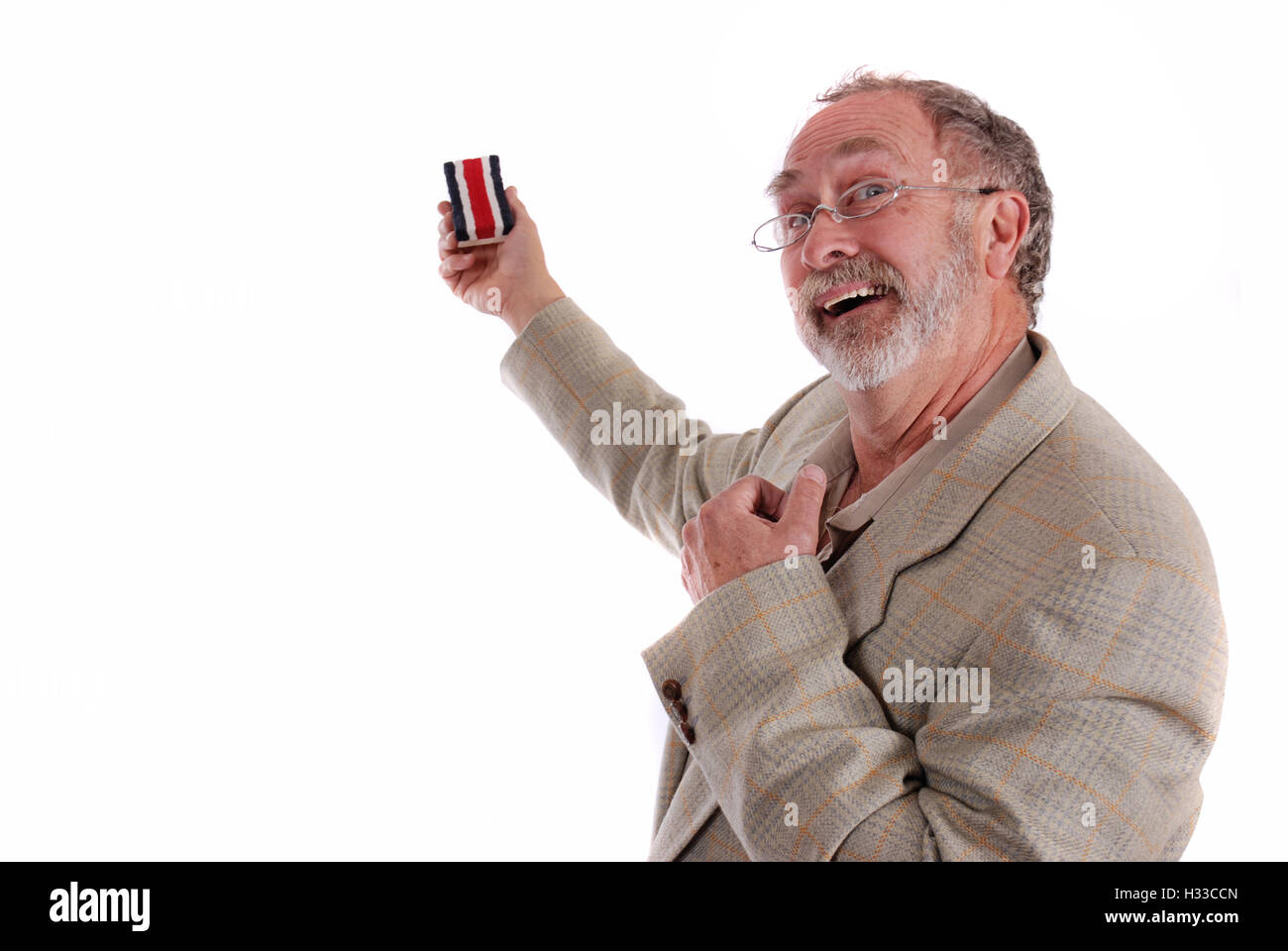 Comical professor gesturing with white board eraser - Stock Image