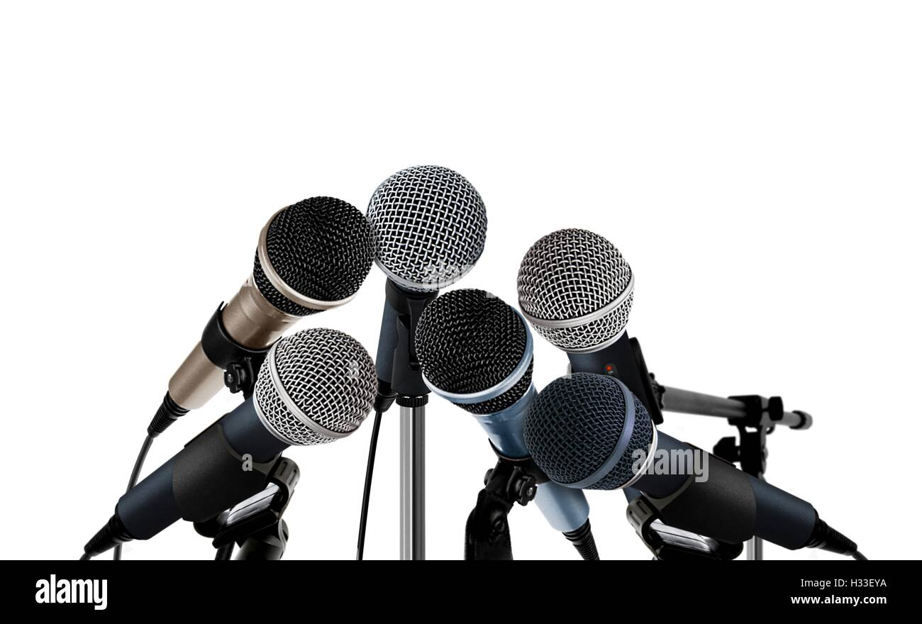 Microphones Standing over White - Stock Image