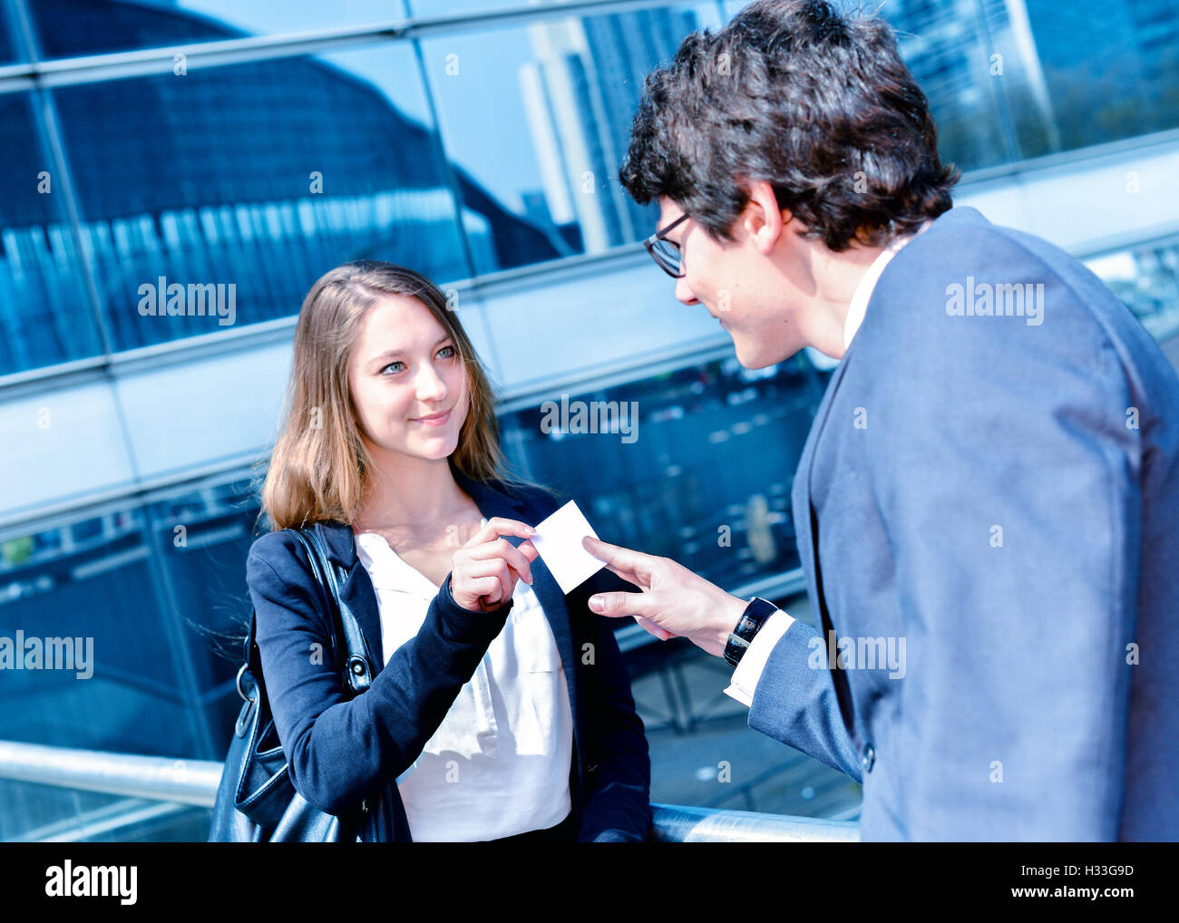 Junior executives dynamics exchange their business cards Stock Photo ...