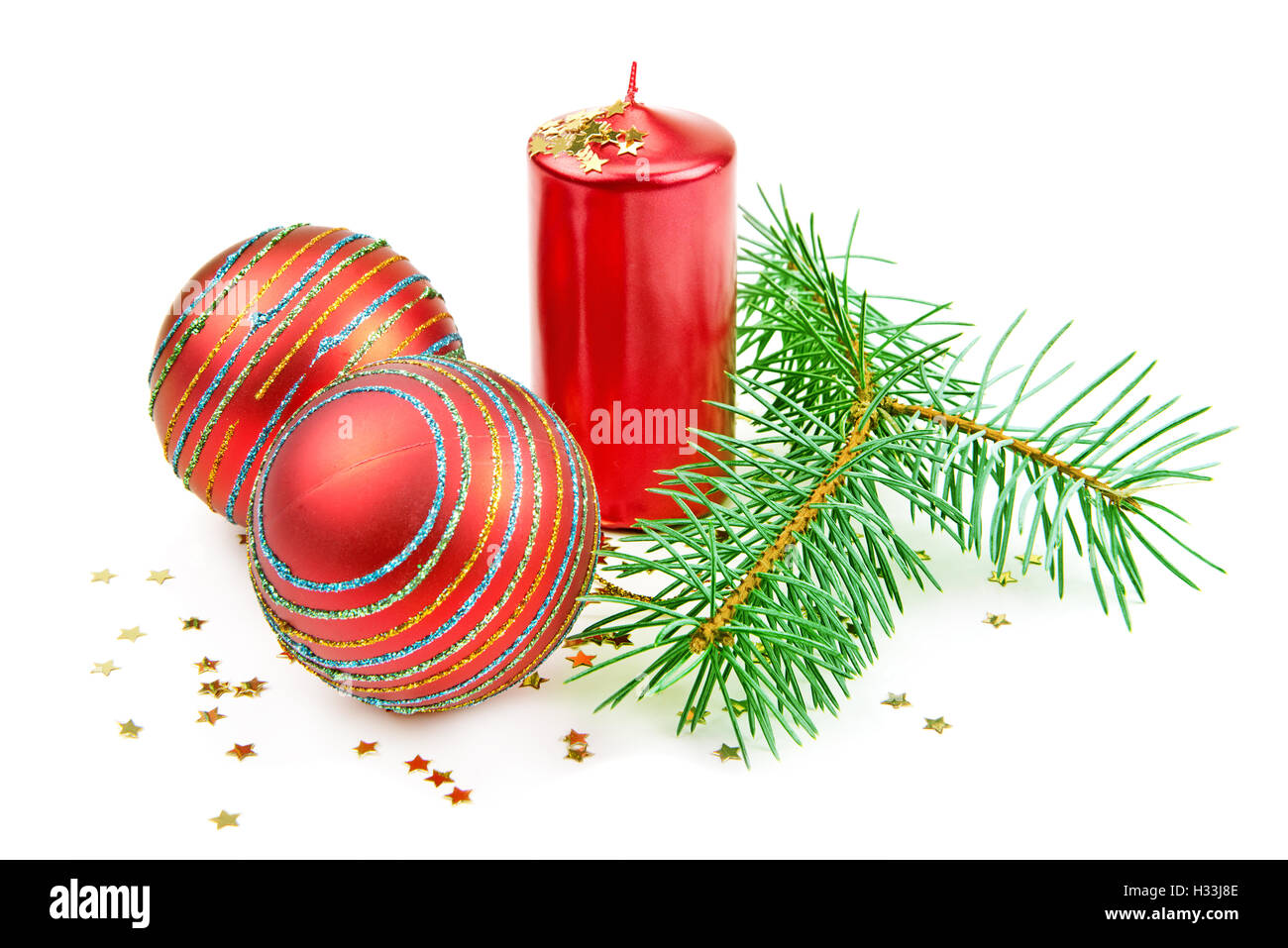Christmas decorations,  candle and fir twig isolated on white background - Stock Image