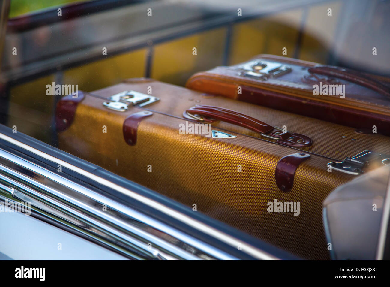 Retro suitcases in vintage car - Stock Image