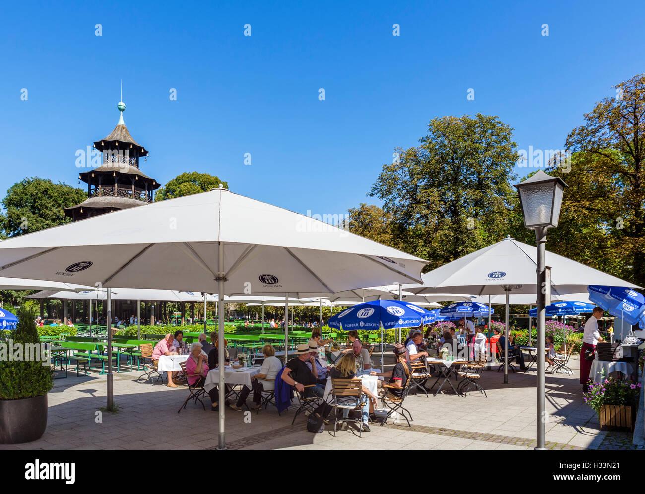 Restaurant at the Chinesischen Turm (Chinese Tower) in the Englischer Garten, Munich, Bavaria, Germany - Stock Image