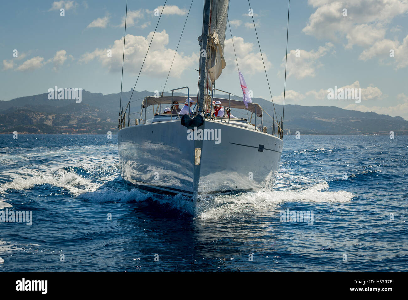 View on the bow of sailing yacht wich is cruising near Porto Cervo, Sardinia. - Stock Image