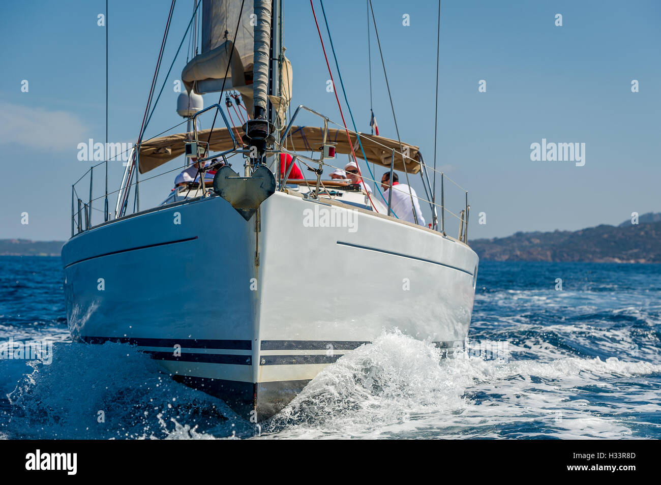 Sailing boat is going straight to the camera. Mediterranean sea cruising. - Stock Image