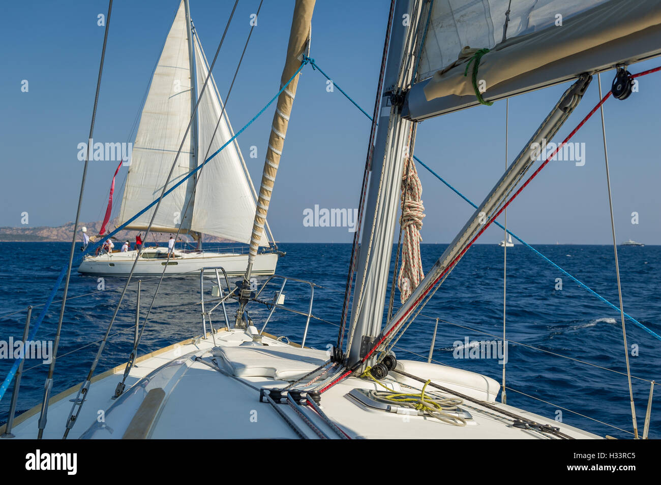 View from one sailing yacht deck to another cruising boat. - Stock Image