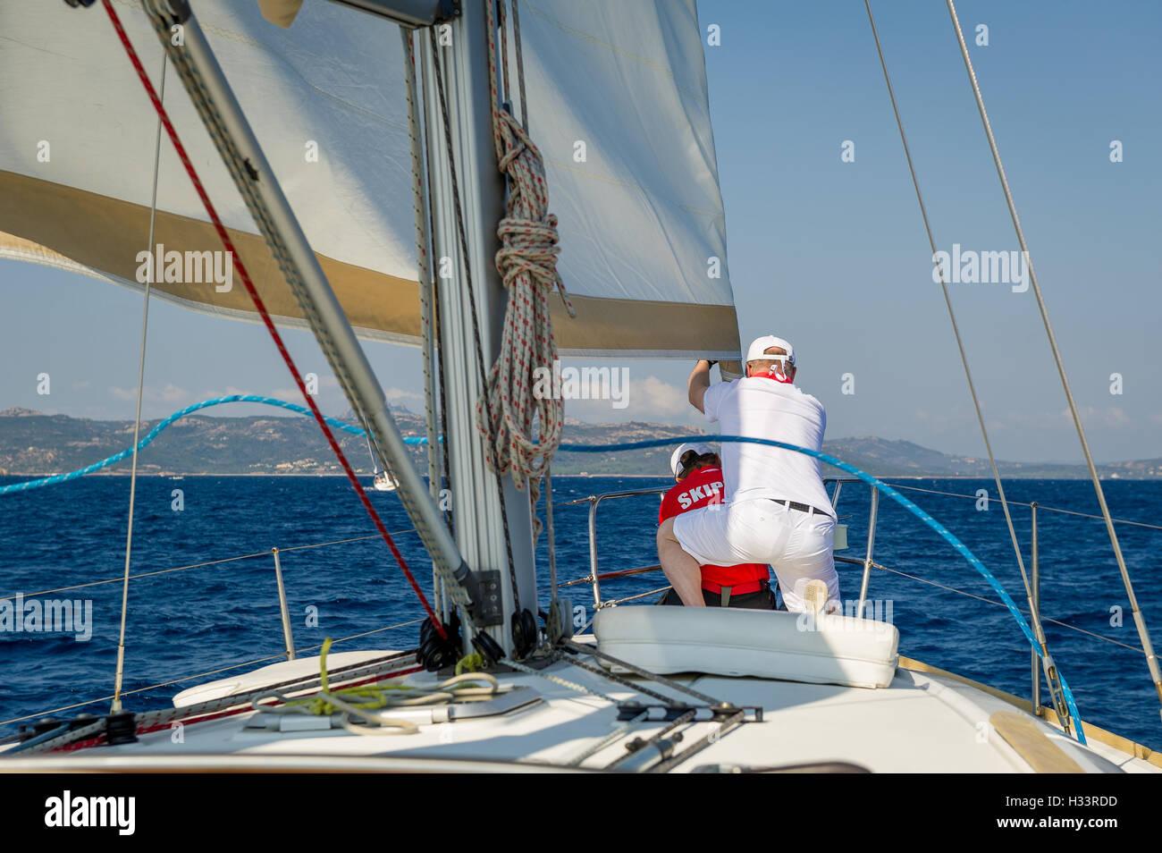 Crew work at sailing race. - Stock Image