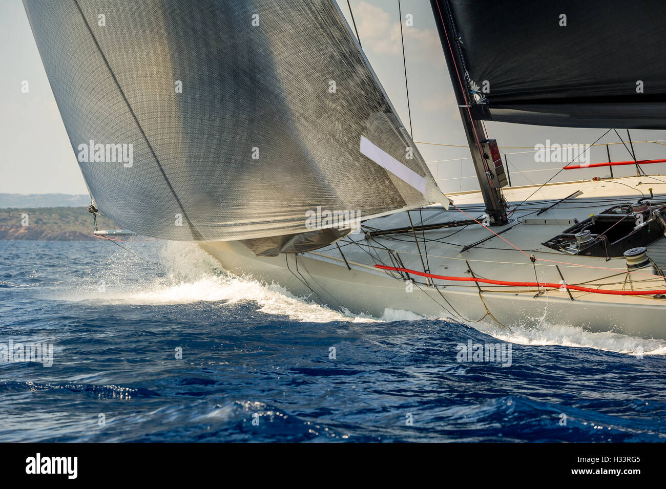 Racing sailing yacht going fast in the Mediterranean sea - Stock Image
