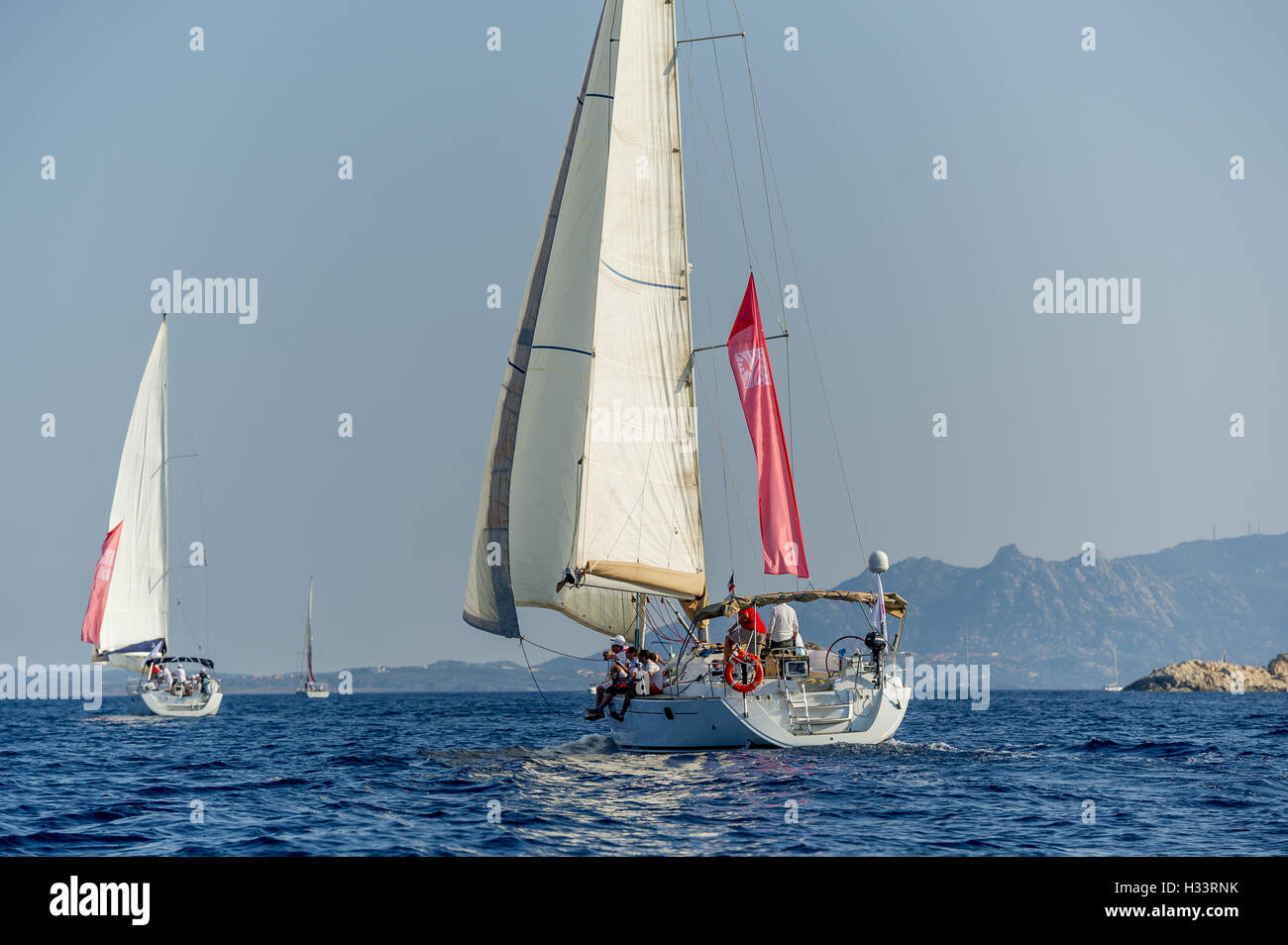 Group of cruising sailboats is sailing in the Mediterranean sea. - Stock Image