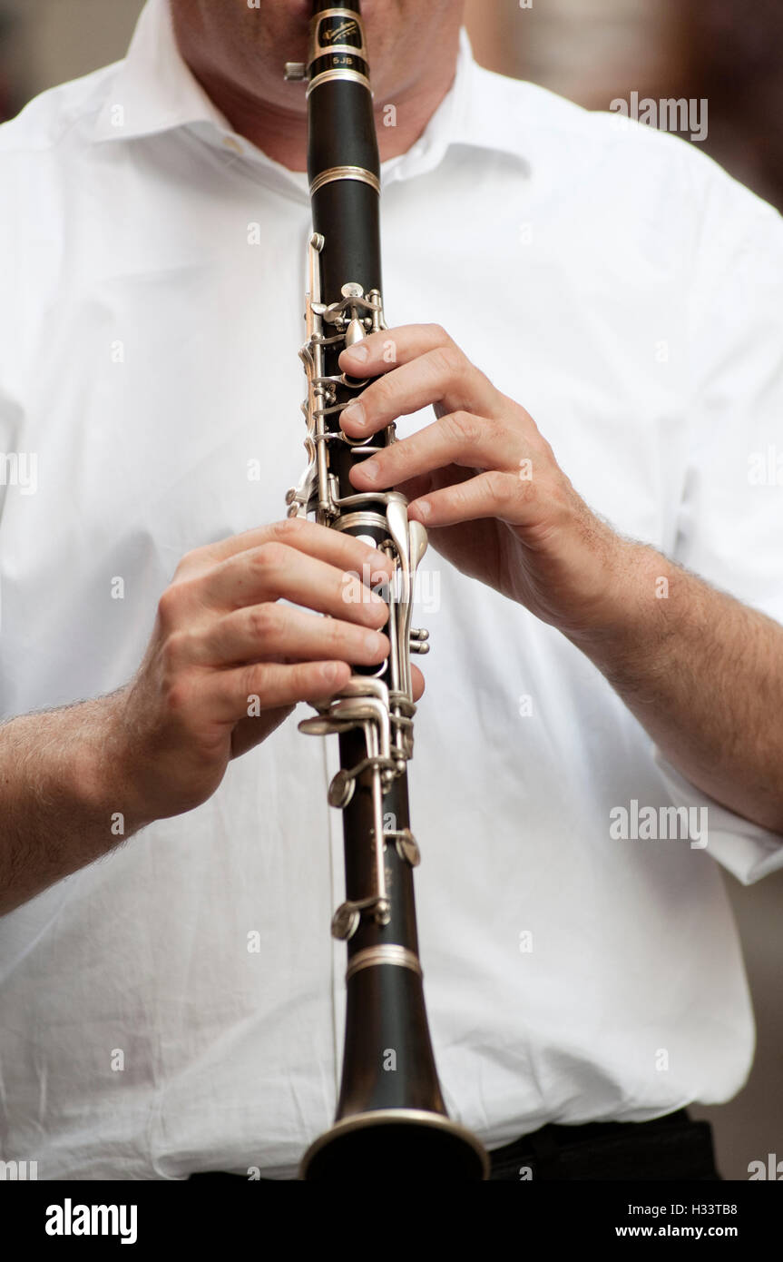 Hands Holding Clarinet - Stock Image